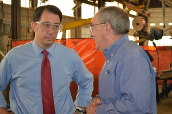 Governor Walker discusses business with Lakeside Steel & Mfg. President Dennis Kehoe.